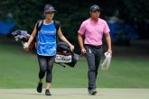 C.T. Pan of Taiwan walks the first green with his wife and caddie Michelle Lin during the third round of the Wyndham Championship at Sedgefield Country Club on August 18, 2018 in Greensboro, North Carolina. (Photo by Kevin C. Cox/Getty Images)