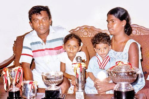 Nandasena Perera with his family