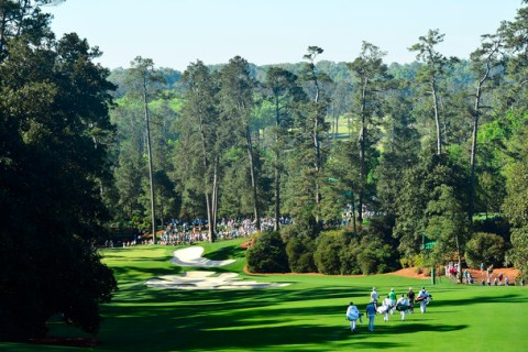 Rickie Fowler, Dustin Johnson and Brooks Koepka walk down hole No. 1 fairway during Practice Round 3 for the Masters at Augusta National Golf Club, Wednesday, April 10, 2019.