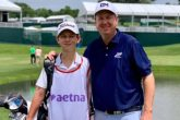 J.J. Henry with his son Connor during a pro-am before his 21st start at the Travelers Championship.