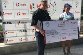 Tvesa Malik receiving winner's cheque