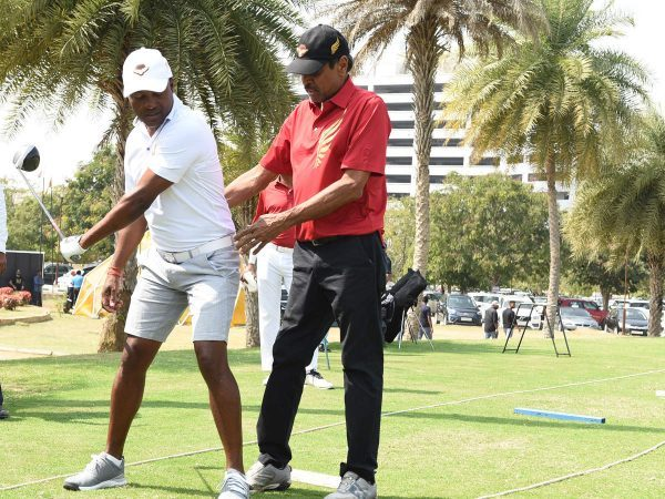 Brian Lara with Kapil Dev - Economic Times Bureau
