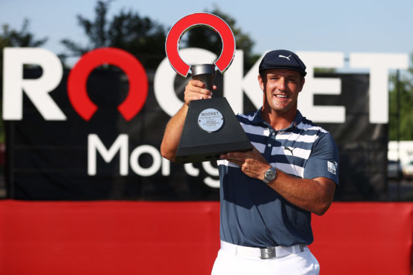 Bryson DeChambeau of the United States celebrates with the trophy after winning during the final round of the Rocket Mortgage Classic on July 05, 2020 at the Detroit Golf Club (Photo by Gregory Shamus/Getty Images)