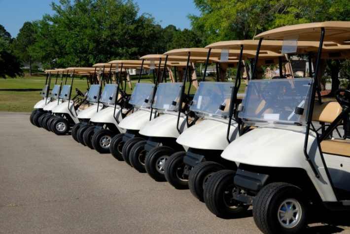 fleet of golf course carts