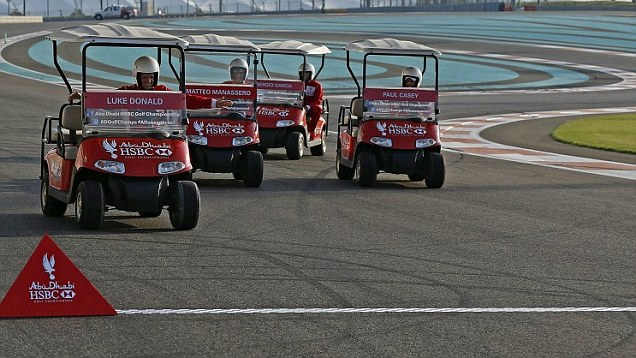 red golf carts racing on a track