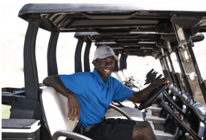 man sitting on the golf cart