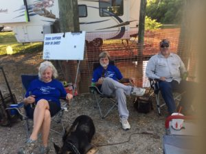 Photo of race officials and visitor relaxing in between racer arrivals.