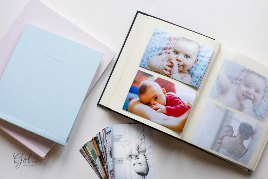 Baby album with more photos and albums around it