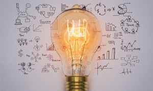 Serviços Agência Goma Branding - Light bulb with drawing graph