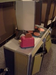 Side view of cardboard kitchen - 1 year later