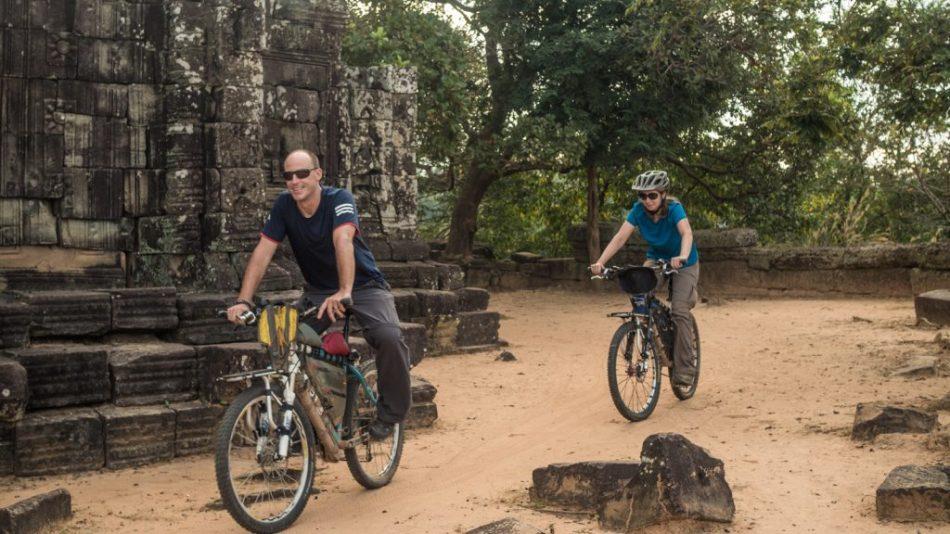 Cycling the wall of Angkor Thom, Cambodia