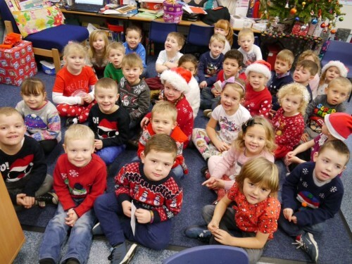 Reception children in their Christmas jumpers.