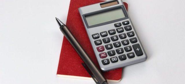 A notepad, a pen and a calculator