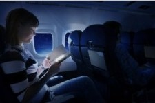 Book Lover On Airplane