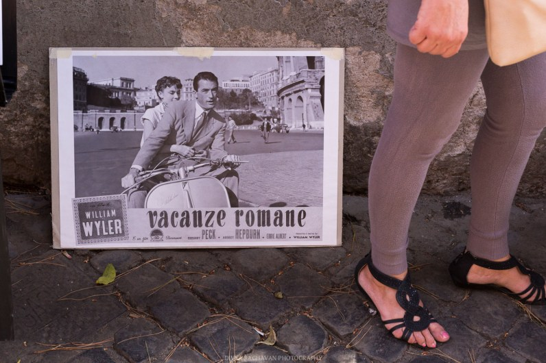 Vintage Vacanza Romane poster in Trastevere, Rome