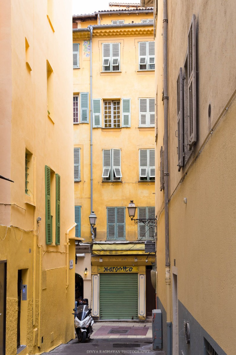 Green shutters and yellow distressed walls in Old Town, Nice-1