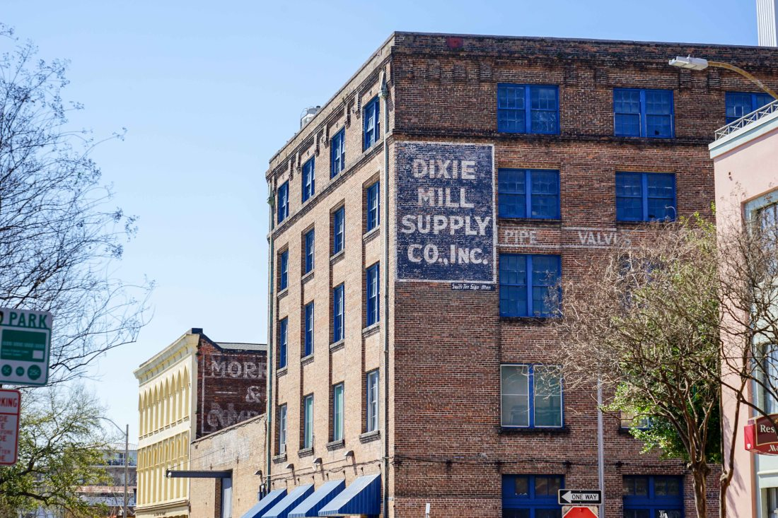 Historic brick buildings and old signs are everywhere.