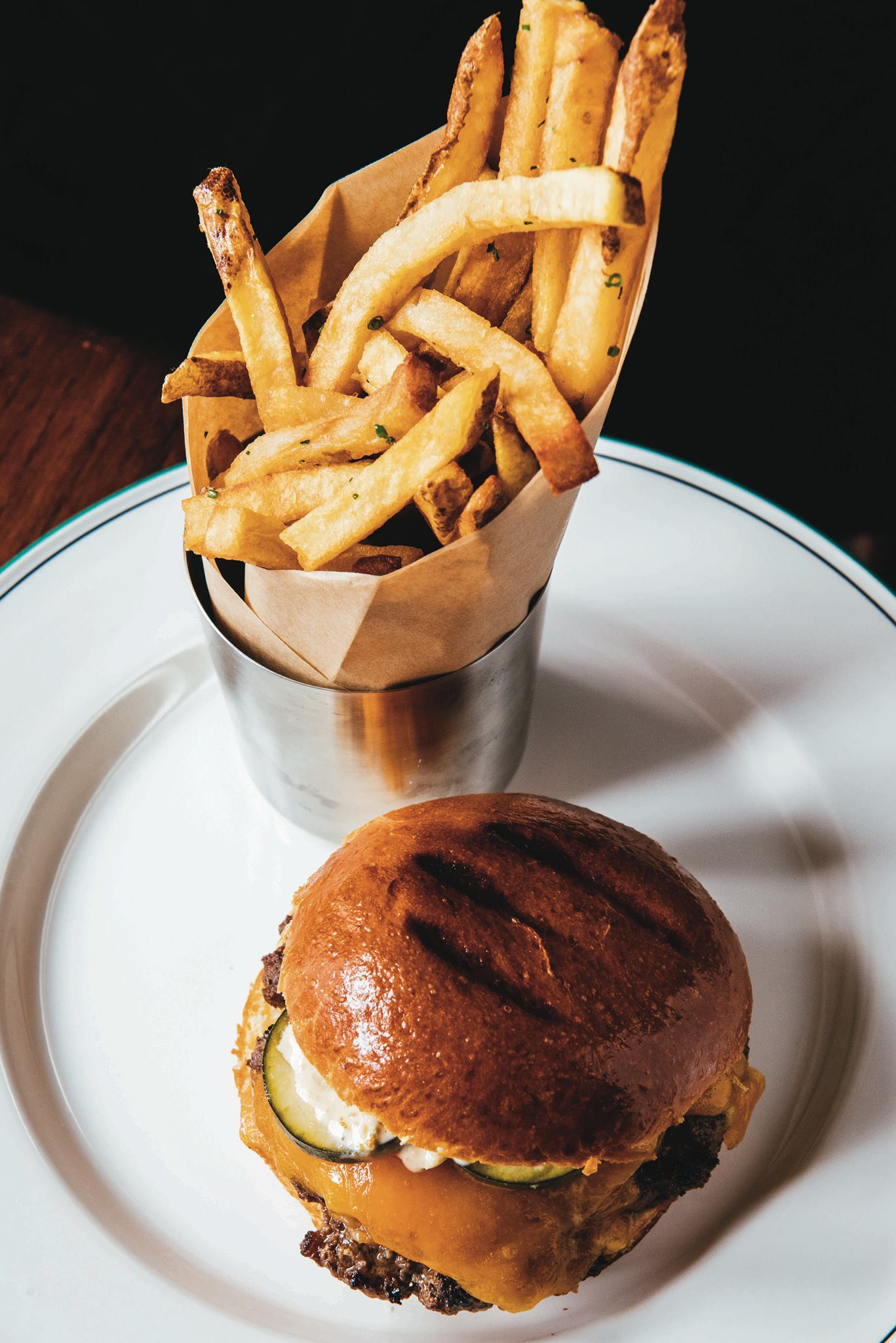 The juicy, flavorful burger at Balise comes on a toasted brioche bun. (Photo via Balise on Facebook)