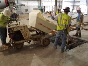 Concrete buggy delivers concrete to paint booth vent pit
