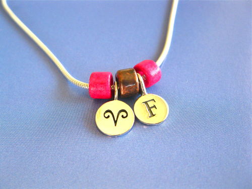 Camino necklace with Aries zodiac disc and initial letter F