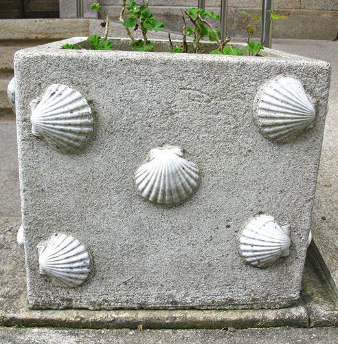 Concha shells on a flower tub in Santiago city, Spain