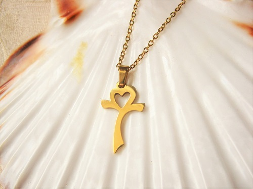 Modern cross symbol with heart