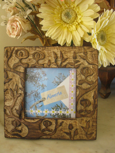 Wooden photo frame with Indalos