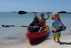 My family's triumphant return to shore after our kayaking expedition (March, 2016)