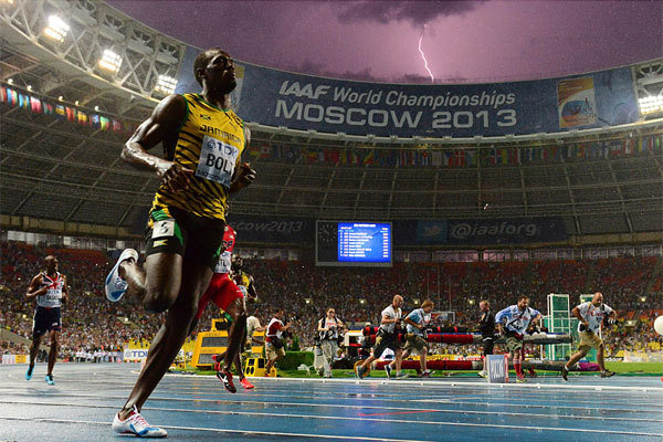 A bolt of lightning strikes just after Jamaican sprinter Usain Bolt wins the 100-meter title at the IAAF world championships in Moscow. (Olivier Morin / AFP/Getty Images / August 11, 2013)