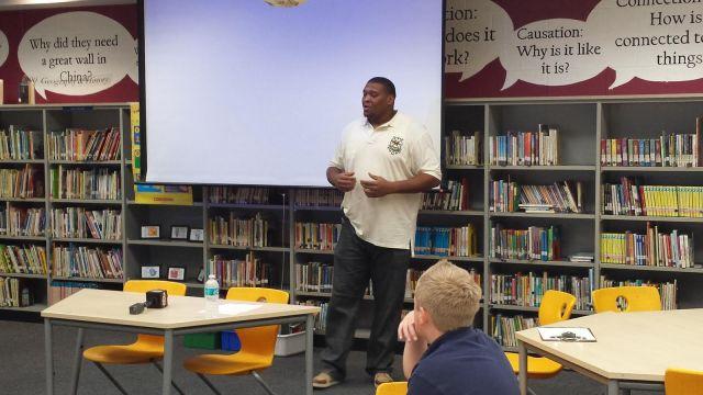 Jacksonville Jaguar Red Bryant Speaking to R.L. Brown Elementary School's GRASP Choice Academy