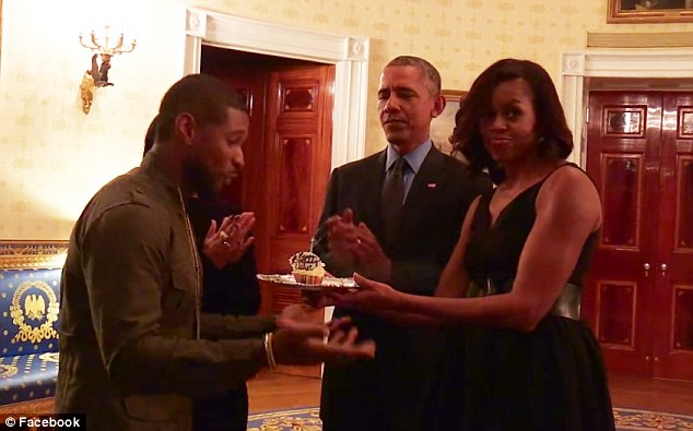 Usher and the Obamas (photo via youtube)