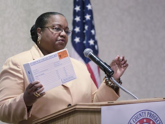 Wayne County Prosecutor Kym Worthy holds up an example of a rape test kit at a press conference at the Atheneum Suite Hotel in Detroit Tuesday Jan. 6, 2015. The Michigan Women's Foundation teams with The Wayne County Prosecutor's Office, which discovered 11,000 untested rape kits in a Detroit police storage unit five years ago, announced today their collaboration to raise $10 million to pay for the testing, investigation and prosecution of those unsolved rape cases. (Mandi Wright/Detroit Free Press)