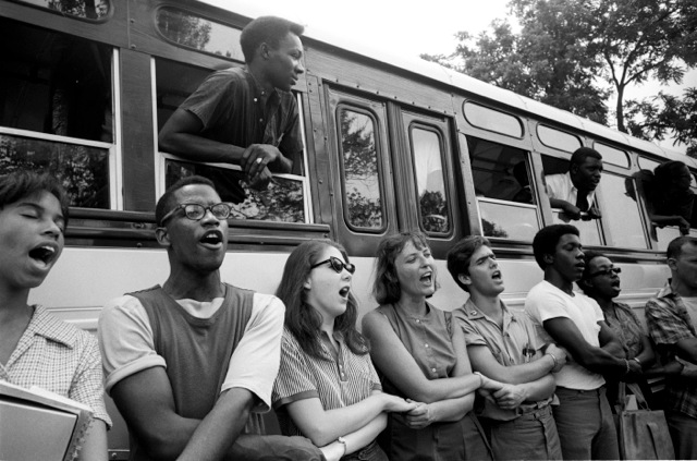 Photo Credit: Steve Schapiro/Corbis –Mississippi Summer Project Workers Link Arms. As part of theMississippi Summer Project students are trained to register Black voters who havebeen denied the vote by discriminatory Jim Crow laws.