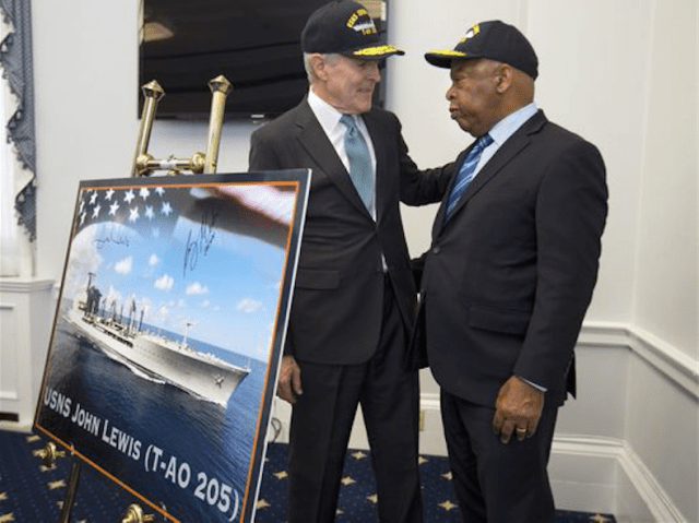 Navy Secretary Ray Mabus, left, talks with Rep. John Lewis, D-Ga., during a ceremony on Capitol Hill in Washington on Wednesday to announce that the next generation of fleet replenishment oilers will be named the USNS John Lewis, after the civil rights movement leader and Georgia's 5th District representative. (Photo: Jacquelyn Martin/AP)