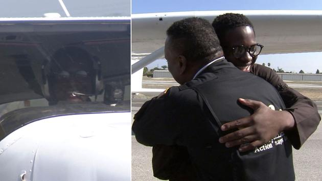 Isaiah Cooper, 16, hugs flight instructor Robin Petgrave upon return from record-setting journey. (Screenshot via abc7.com)