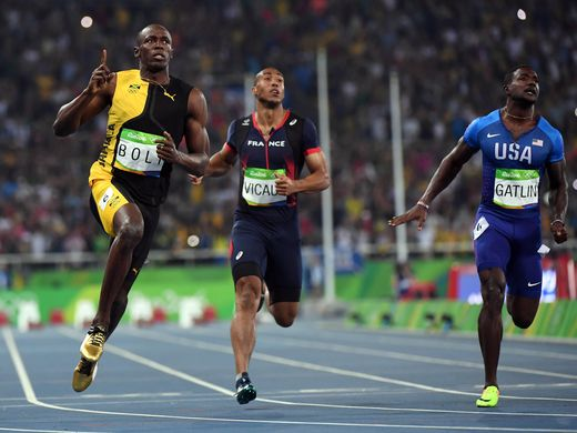 Usain Bolt of Jamaica wins 3rd consecutive Gold Medal in men's 100M race (photo via usatoday.com)