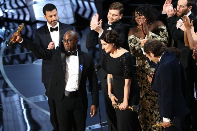 "Barry Jenkins accepts Best Picture Oscar for ""Moonlight"" (Patrick T. Fallon via nytimes.com)"