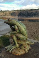 Whimsy on the waterfront. Froggy sculpture placed where two pathways meet. Artist: Ralph Trethewey