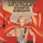 Sword-Dancer by Jennifer Roberson, despite it's awful cover is a wonderful fantasy read with sexytimes and kissing.