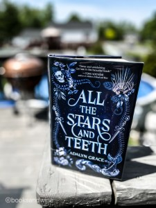 All The Stars And Teeth by Adalyn Grace was right up my alley. This YA debut is a unique fantasy story about a princess who will do anything to save her kingdom.