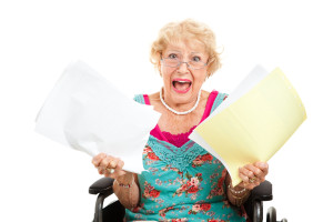 Disabled senior woman screaming in frustration about her medical bills. Isolated on white.