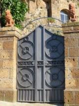 Elegant gate to a palazzo in Cività.