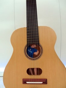 The Pacific Science Center features some over-sized instruments. Here William plays the guitar.