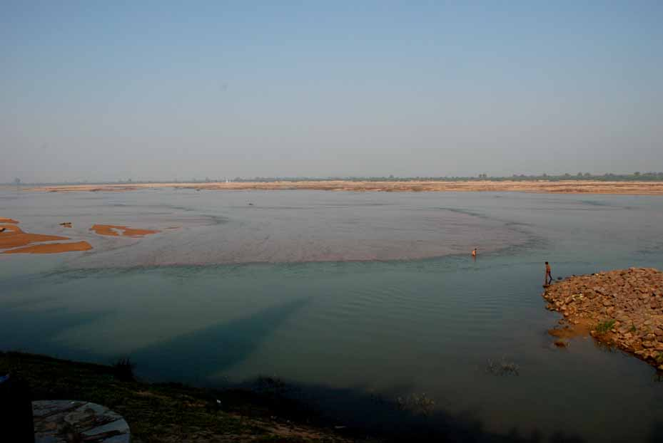 Shadow of the shikhara of a Sirpur temple on the waters of the Mahanadi