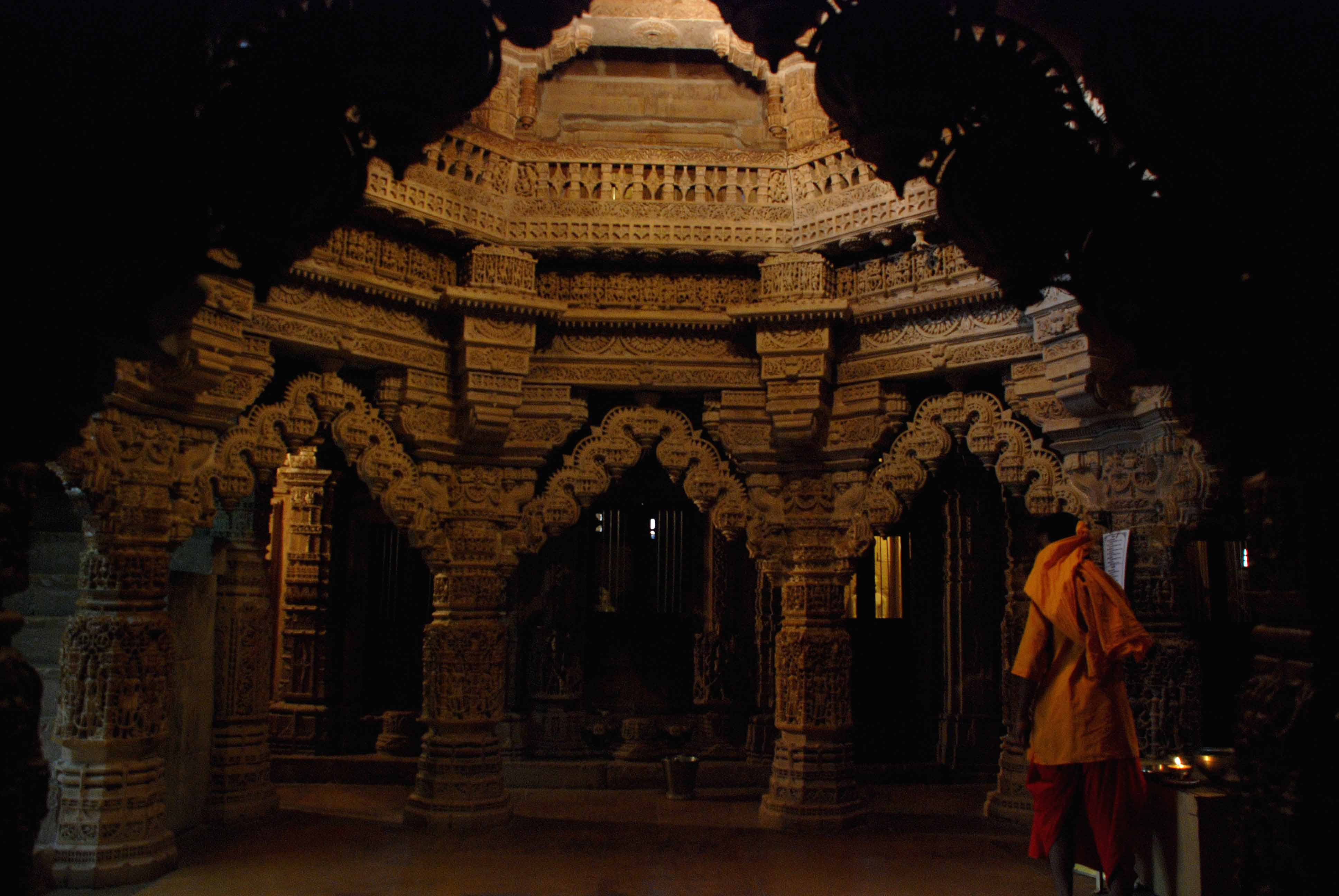 A priest walks past the central neve of the Jain temple in Jaisalmer fort