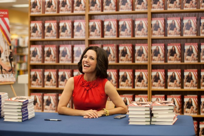 Selina signs her book