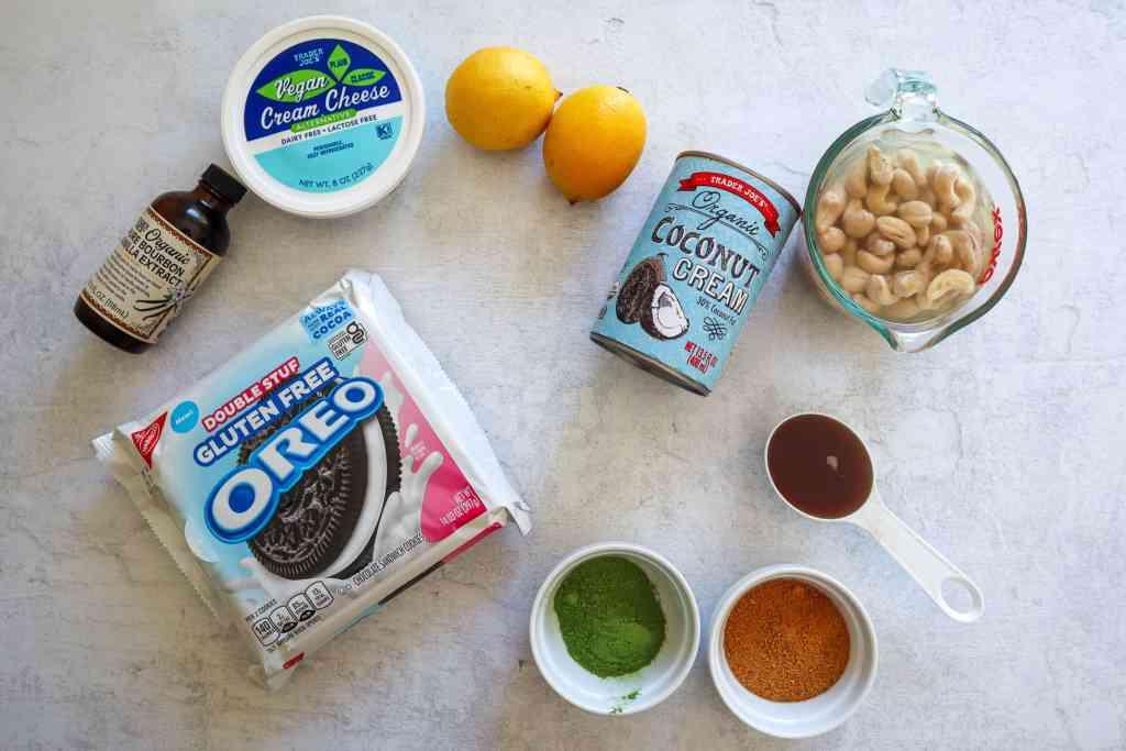 Ingredients Needed to make Vegan Matcha Cheesecake: vanilla extract, gluten free Oreos, coconut cream, matcha powder, coconut sugar, maple syrup, soaked cashews, vegan cream cheese, lemon