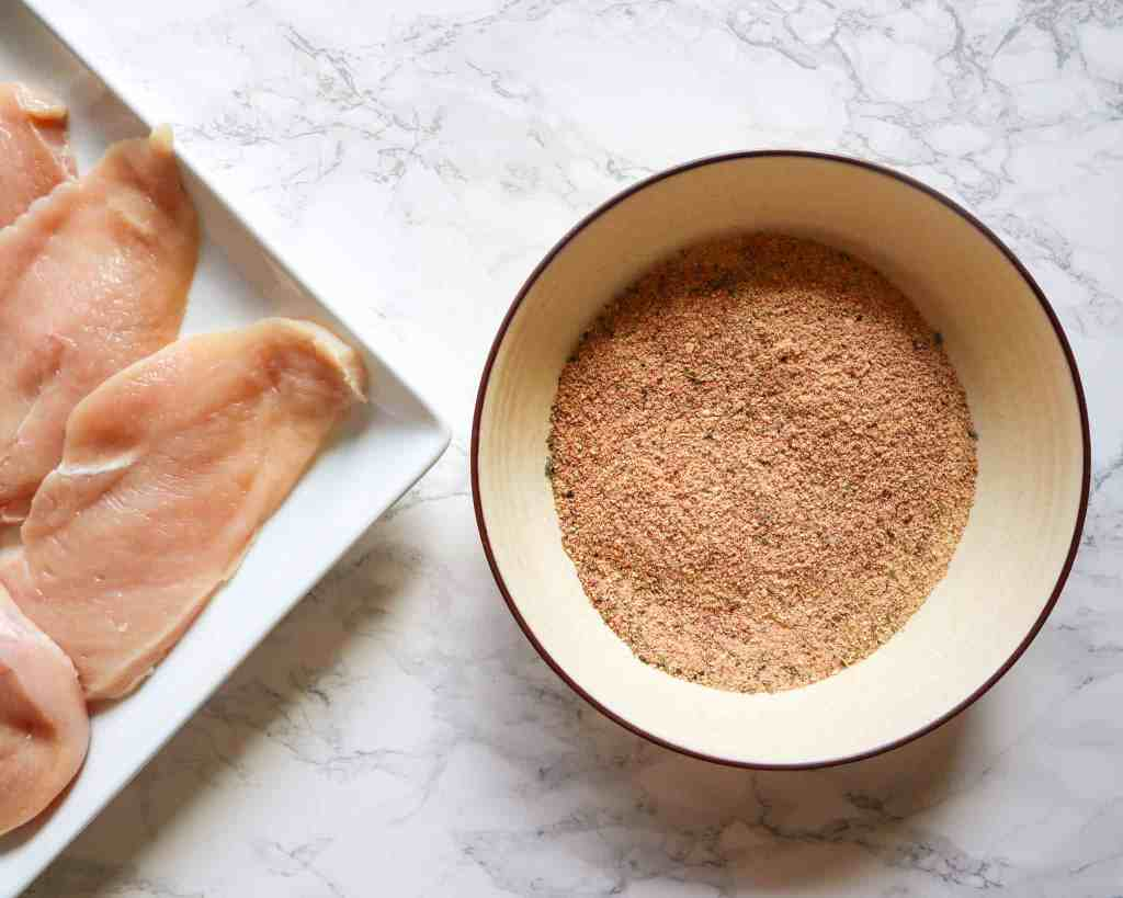 step1-mix-breadcrumbs-and-seasonings-together-and-add-olive-oil-to-chicken