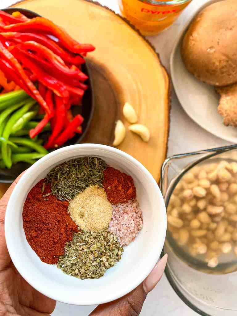 ingredients to make Vegan Creamy Cajun Pasta with peppers and mushrooms and cajun spices