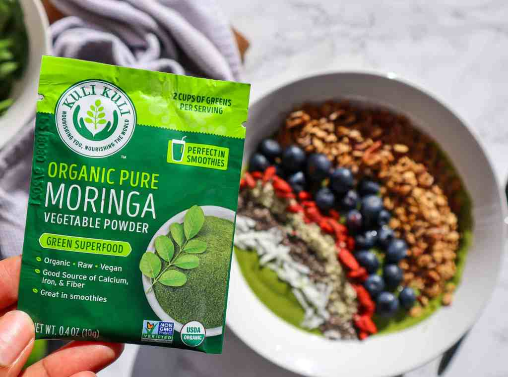 Moringa Powder Packet with smoothie bowl in background